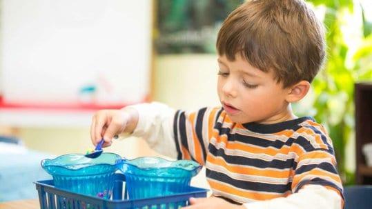 Little boy learning at Children's Magnet Montessori school.