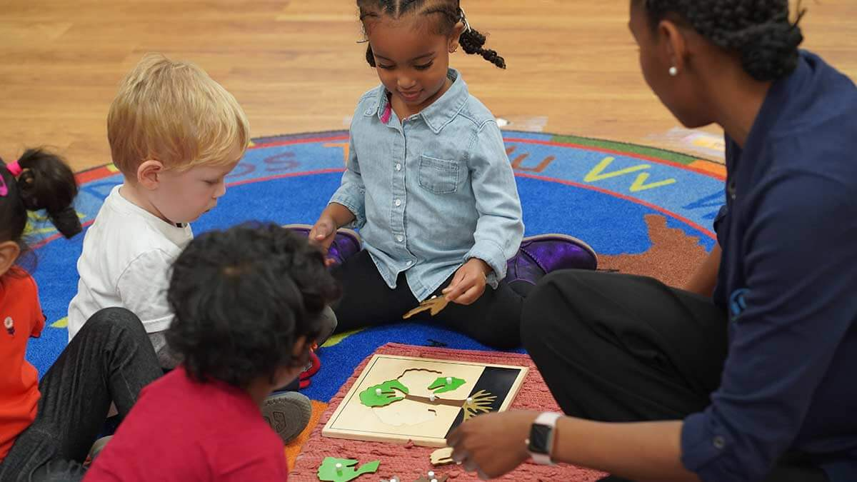 Teacher with students at preschool in Maryland.