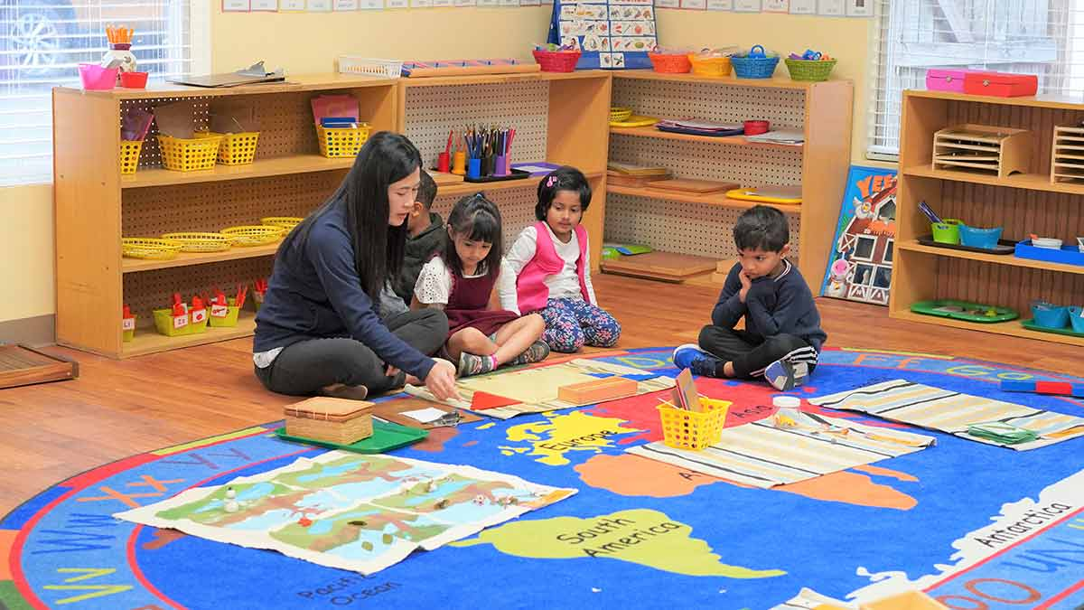 Children learning at the primary Montessori programs.