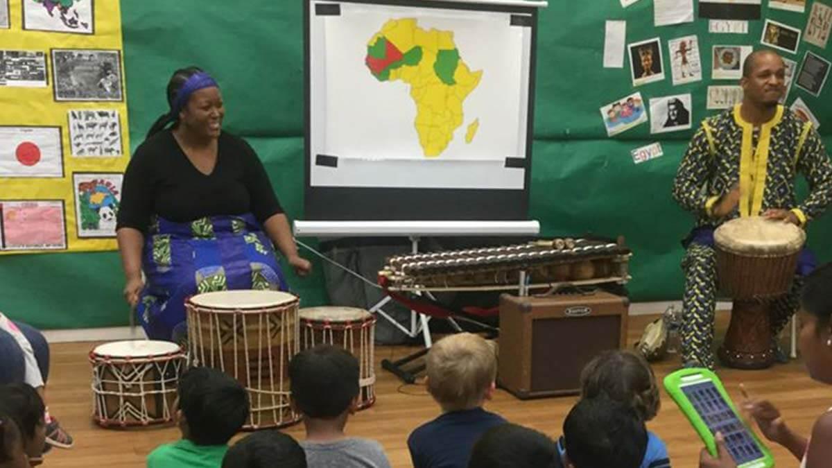 Children enjoying live music at a Montessori School program.