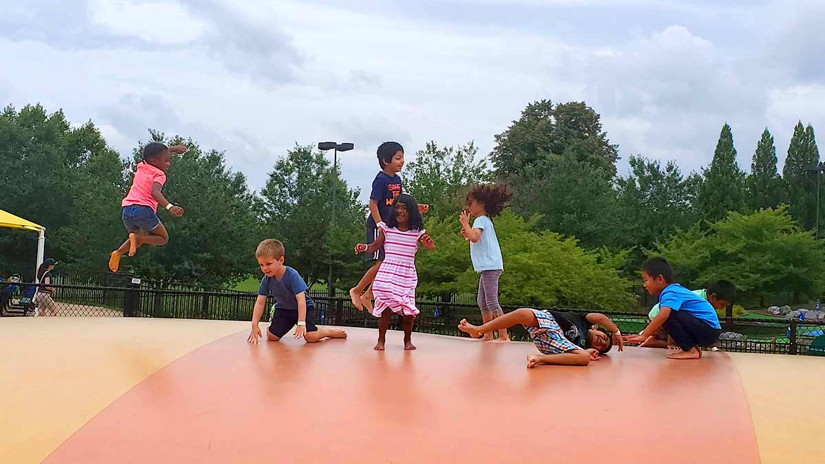 Children enjoying the outdoors at a Montessori School program.